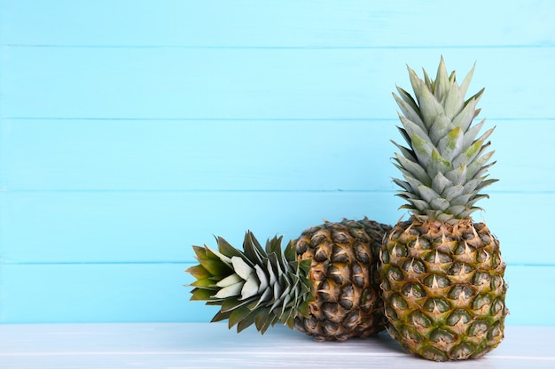 Two ripe pineapples on a blue background with copy space Premium Photo