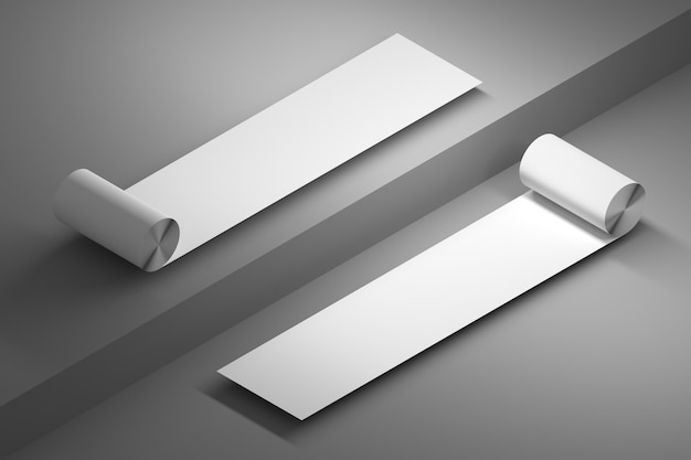 Two rolls of duct paper with blank empty surfaces over gray floor Premium Photo