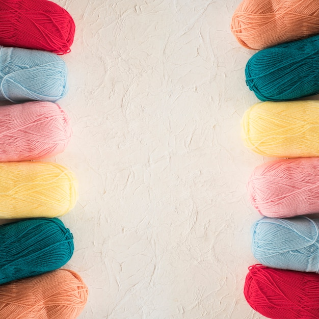 Two rows of colorful yarn Free Photo