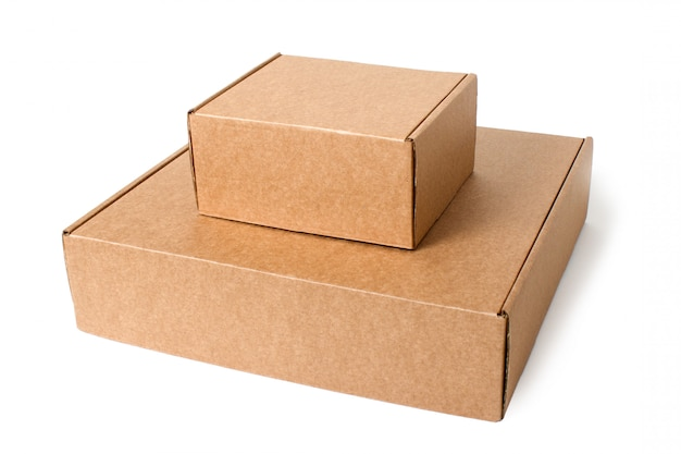 Two self-gathering cardboard boxes isolated on white. Premium Photo