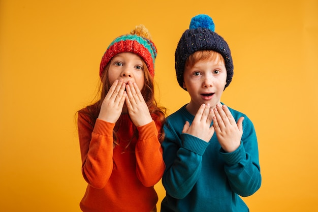 Two shocked surprised little children Free Photo