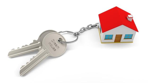 Два серебряных ключа с цепочкой для ключей от дома с надписью dream house, все изолированные на белой стене. брелок для ключей 3d home. концепция недвижимости с домом и ключом Premium Фотографии