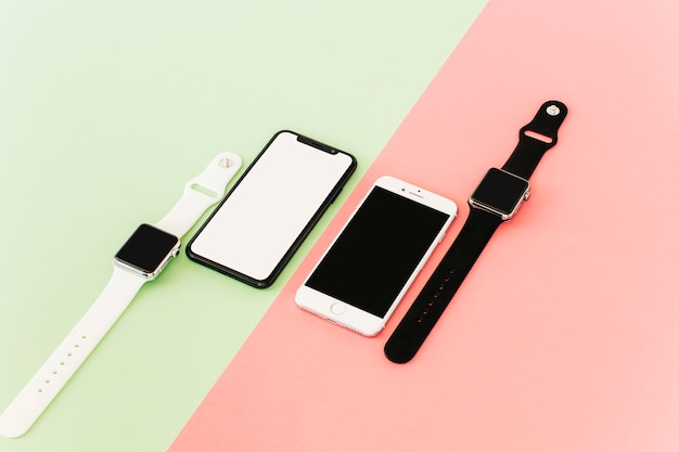 Two smartphones and smartwatches Free Photo
