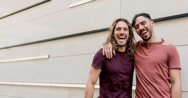 Two smiley friends looking at camera Free Photo