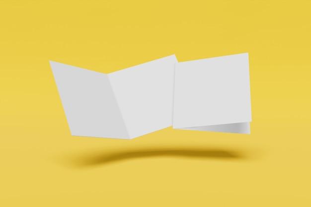 노란색 배경에 고립 된 두 개의 사각형 소책자 프리미엄 사진