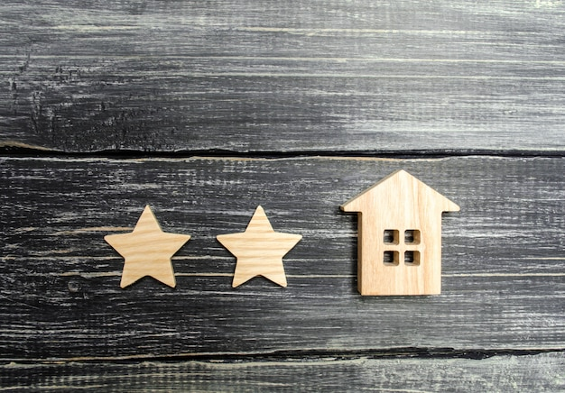 Two stars and a house. concept of the rating of a hotel or restaurant. Premium Photo