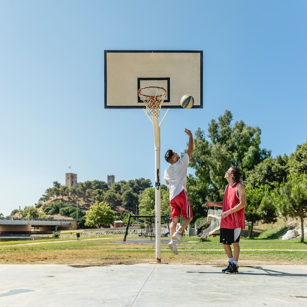 Two street player playing basketball Free Photo