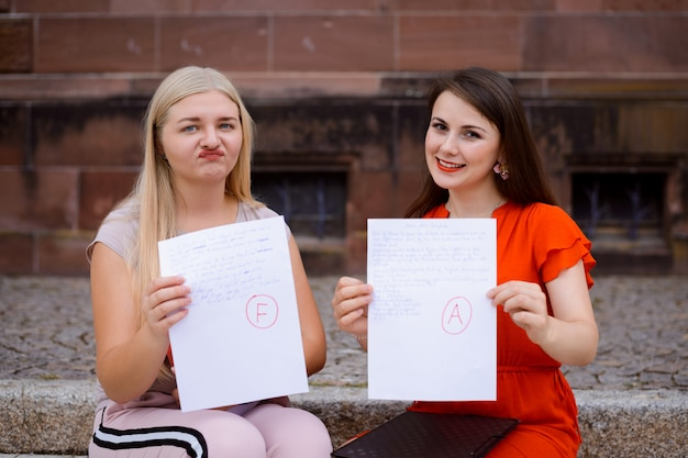 Two students received papers with final test result Premium Photo