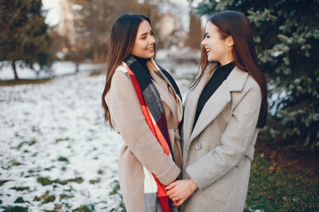 Two stylish girls have a rest in a city Free Photo