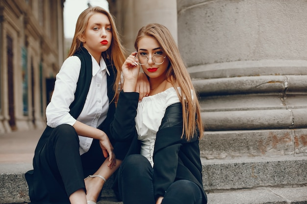Two stylish girls in a summer city Free Photo