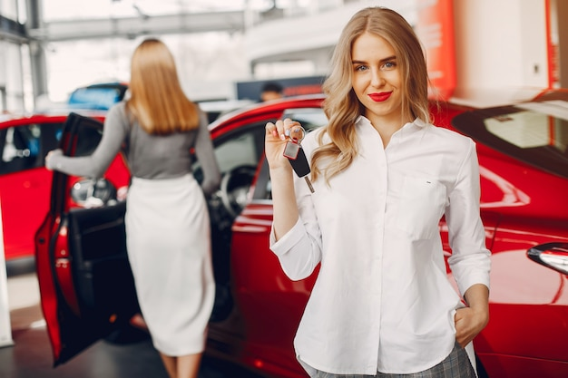 Two stylish women in a car salon Free Photo
