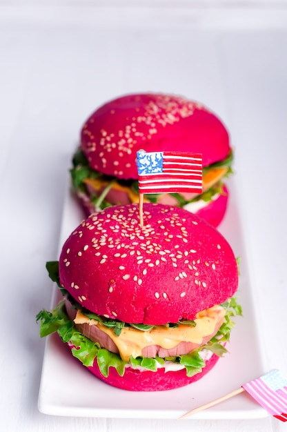 Two Tasty Hamburgers With Little American Flags Photo