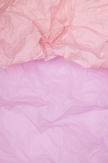 ツートンピンクのしわくちゃの紙のテクスチャ、ピンクの背景、壁紙、verticall Premium写真