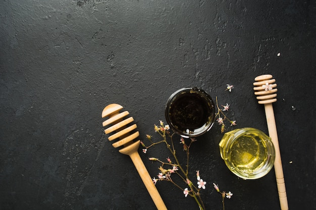 Two type of healthy organic natural honey with spoons and small flowers Premium Photo