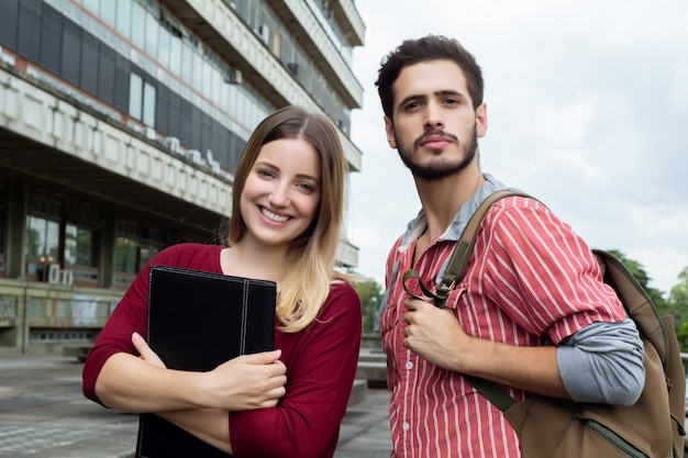 Two university students studying together outdoors Premium Photo