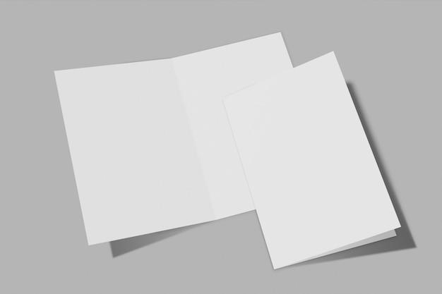 회색 배경에 고립 된 두 개의 수직 소책자 프리미엄 사진