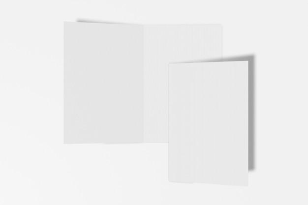 흰 배경에 고립 된 두 개의 수직 소책자 프리미엄 사진