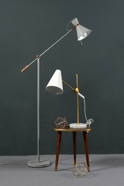 Two vintage anglepoise lamps in a grey interior Premium Photo