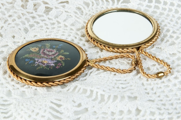 Two vintage brass hand mirror Premium Photo