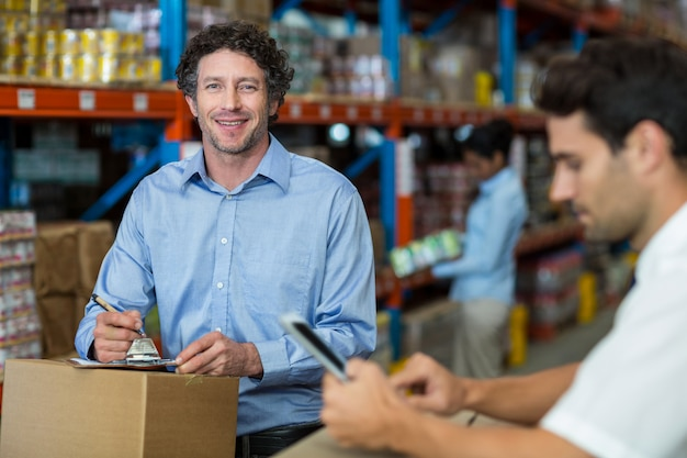 Two warehouse workers working together Premium Photo