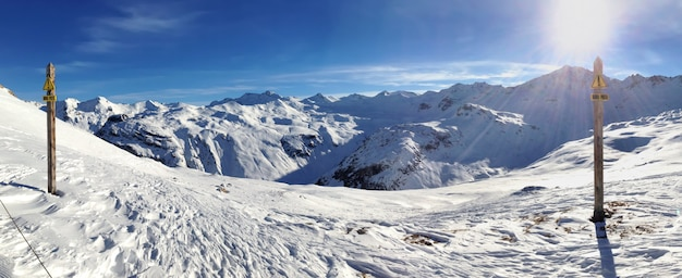Two warning signs off- track writting in french in snowy mountain landscape under sunny blue sky Premium Photo