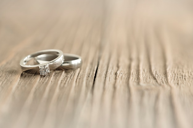 Two Wedding Rings Place On Wooden Background Photo Premium Download