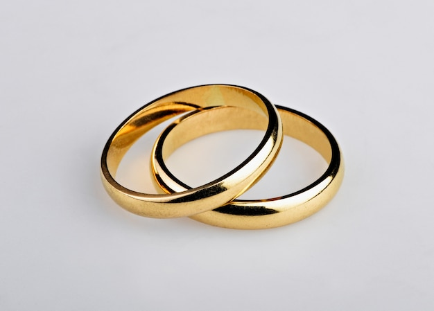 Two well used golden wedding rings Premium Photo