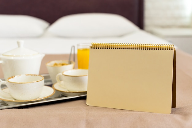 Two white mugs on a tray white bed, breakfast concept Premium Photo