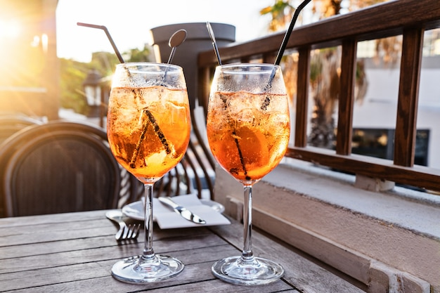Two wine glass of cold cocktail aperol spritz on table Premium Photo