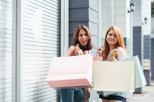 Two women are shopping happily Premium Photo