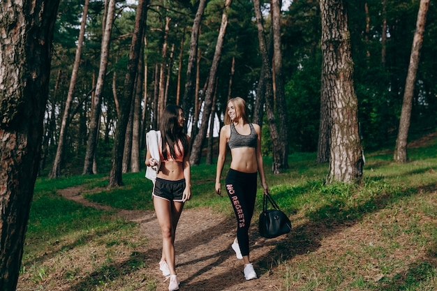 Two women walk around after training Premium Photo