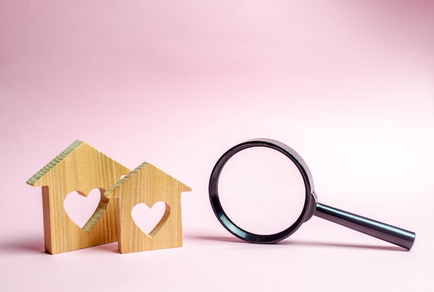Two wooden house with a heart Premium Photo