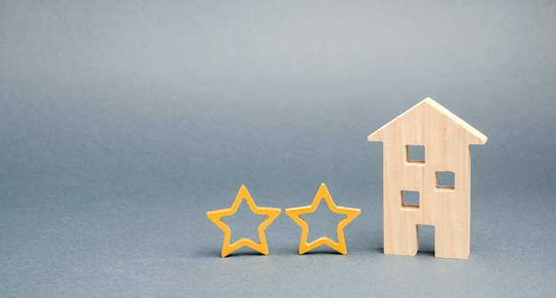 Two wooden stars and a house. Premium Photo