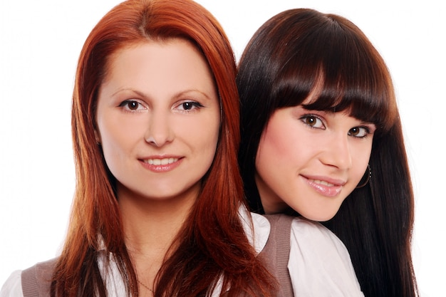 Two young and beautiful sisters Free Photo