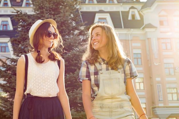 Two young girlfriends having fun in city Premium Photo