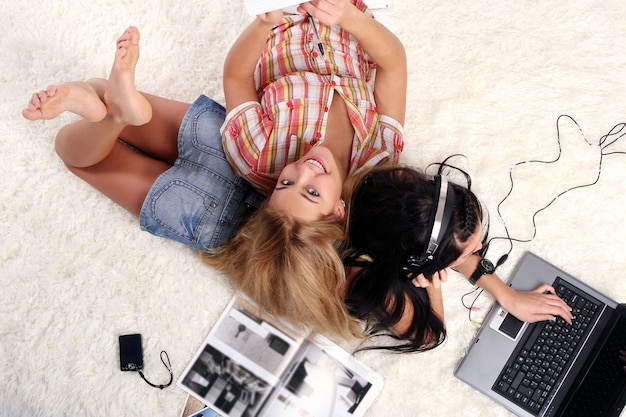 A two young girls at home Free Photo