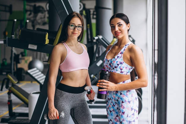 Two young girls training at gym with equipment Free Photo