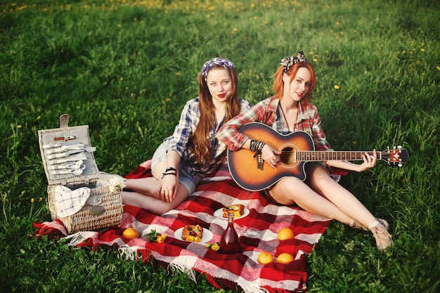 Two young happy girl on picnic Premium Photo