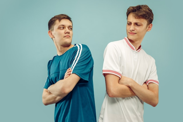 Two young men standing in sportwear isolated. fans of sport, football or soccer club or team. friends' half-length portrait. concept of human emotions, facial expression. Free Photo