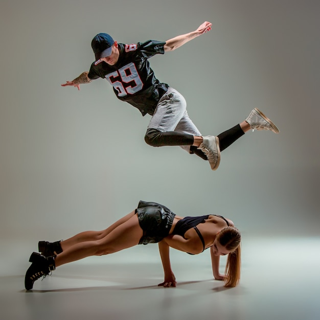 The two young woman and boy dancing hip hop Free Photo
