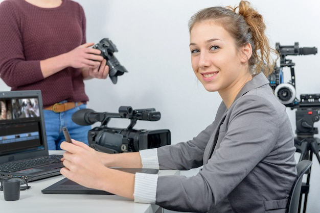 Two young women video editor working with laptop Premium Photo