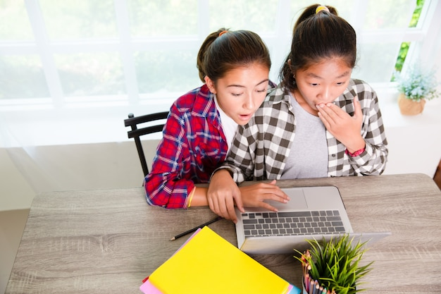 Two youngster looking computer screen and surprised frustrated or disappointed of trouble Premium Photo
