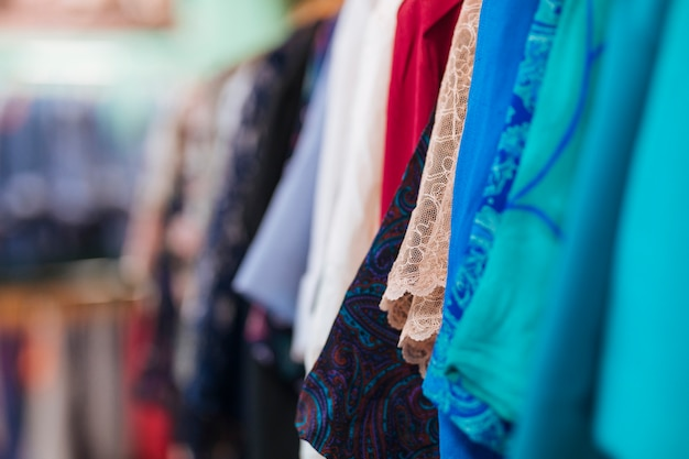 Type of clothes hanging on the rail in the store Free Photo