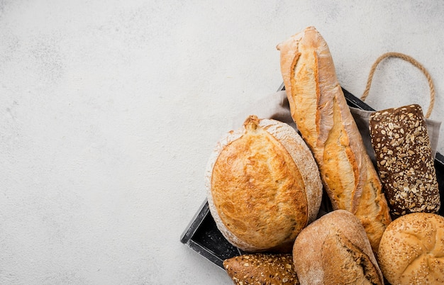 Types of bread on tray and copy space Free Photo
