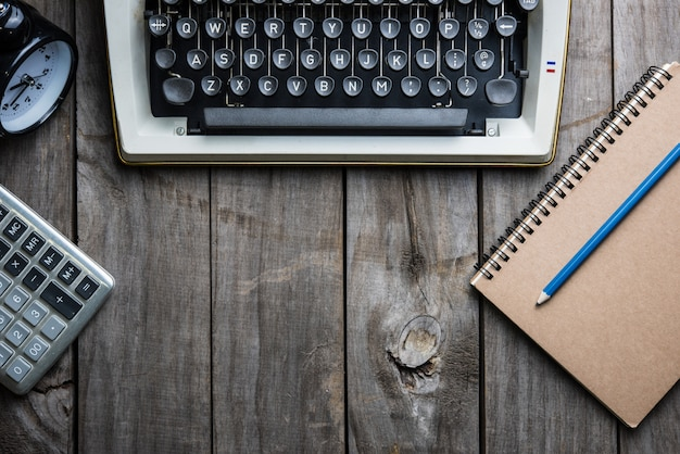 Typewriter retro hand on wooden table Premium Photo