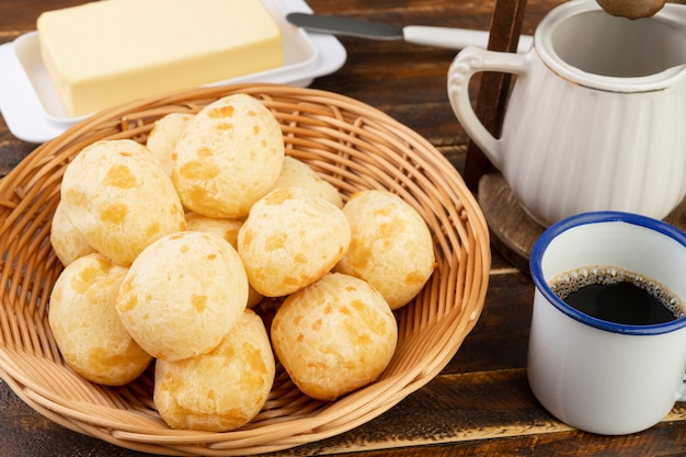 Typical brazilian cheese bun on a basket with butter and coffee Premium Photo