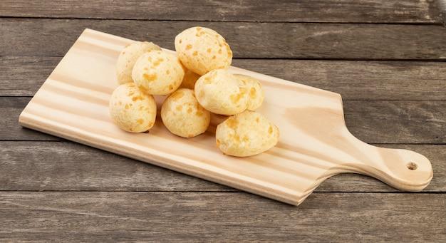 Typical brazilian cheese bun over a wooden board. Premium Photo