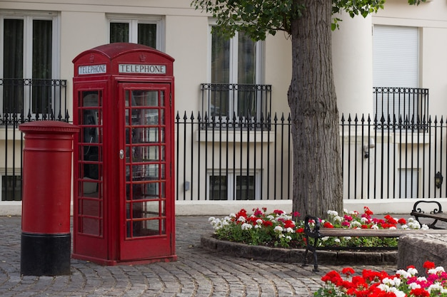 A typical english call box and a typical english post box Premium Photo