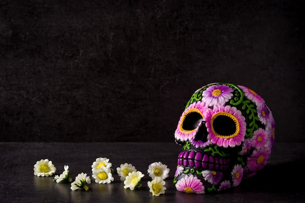 Typical mexican skull painted on black. Premium Photo