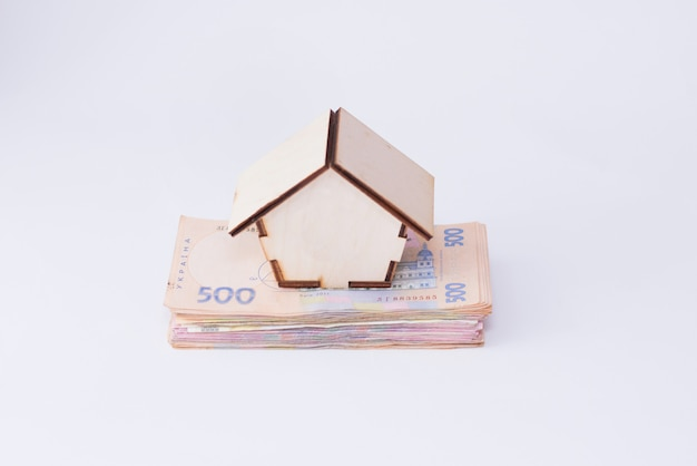 Uah hryvnia banknotes with wooden house isolated on white background Premium Photo